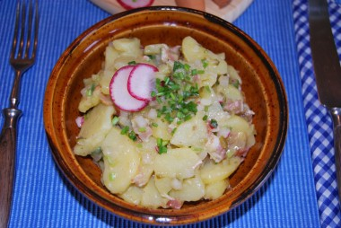 You'll find two types of potato-salad in Germany. In the north of Germany they use mayonnaise for the potato-salad. And in the southern part of Germany they use vegetable broth for the potato-salad mostly with radish and many chives.